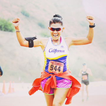 Woman Celebrating Victory in a Marathon